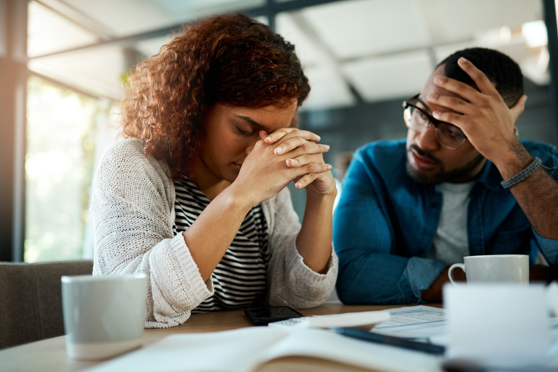 Stressed couple reviewing finances