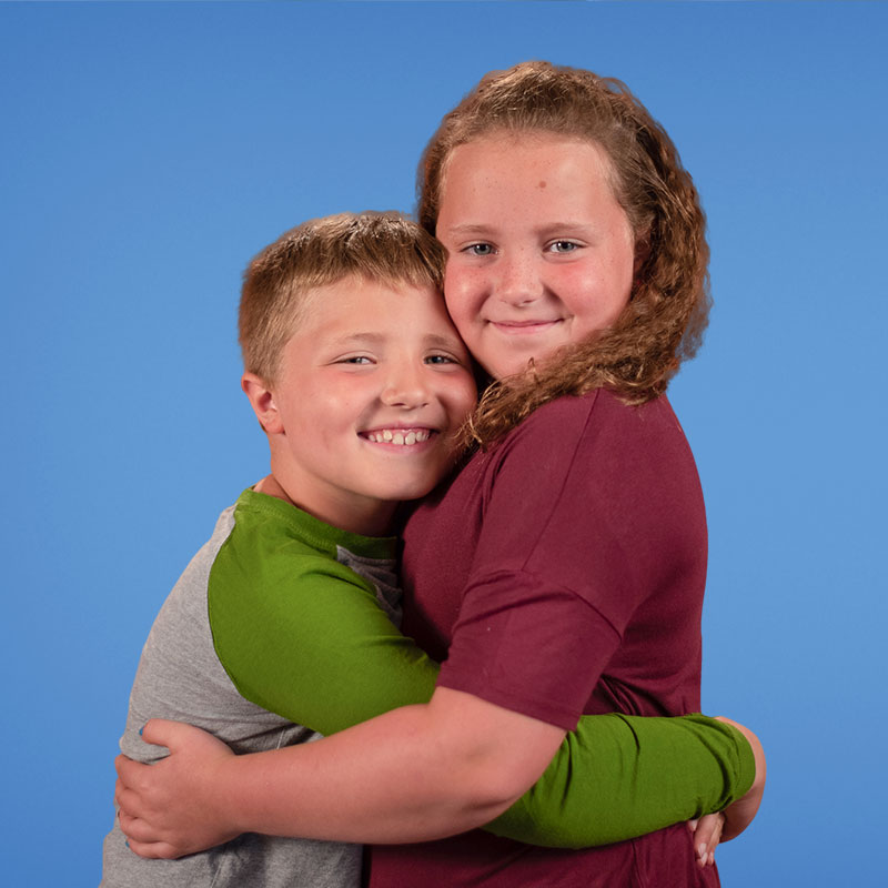two siblings hugging