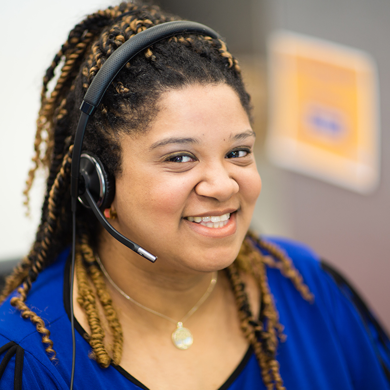 Lady on the phone at a call center